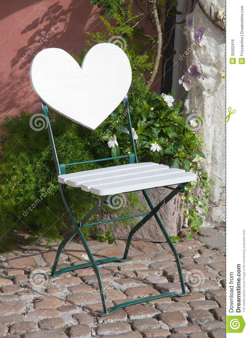 Garden Chair With Heart Shape Backrest On Cobblestone With Flowe Patio Landscaping Garden Patio Furniture Luxury Garden Furniture