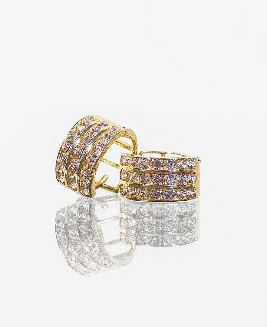 59f1c1d37b12 Huggies de oro amarillo con zirconias blancas  Aretes  Oro  Zirconias   Earings