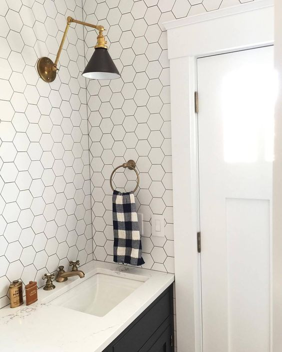 White Hexagonal Tiles With Black Grout And Black Cabinets Don T Like Sink Right Up To Wall And Door Mo Bathroom Tile Designs Bathroom Decor Bathrooms Remodel