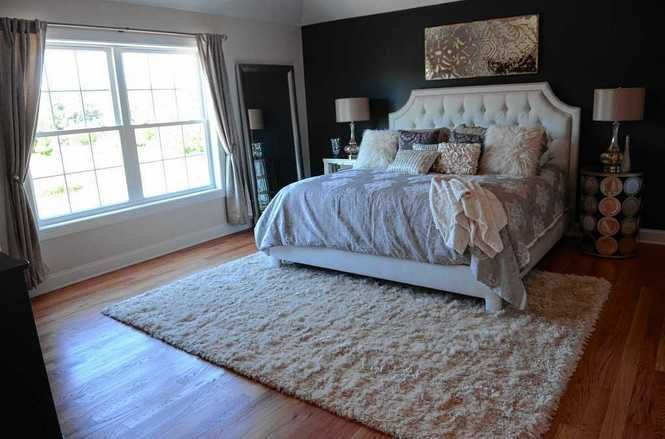 Like the contrast between the wall and bed.  Like the comfy look of bed.