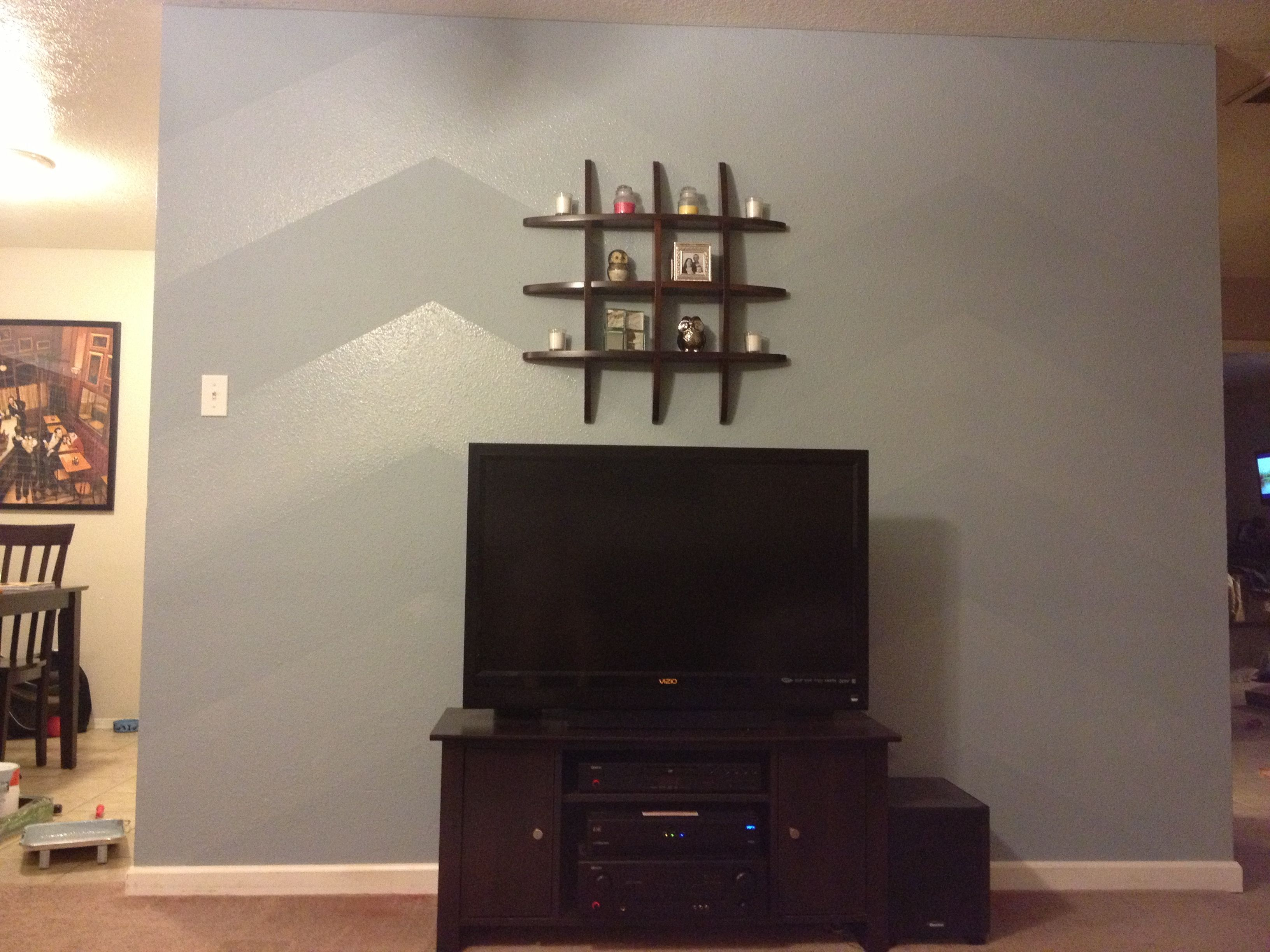 Chevron accent wall in living room. Used flat and hi-gloss ...