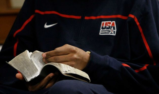 """Teen hoops star Jabari Parker reads his """"quad"""" during early morning seminary."""