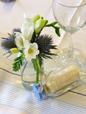 Styling tables with eclectic jars and bottles filled with scented freesia's, and sea holly set a real vintage coastal mood.
