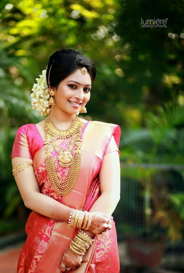 Traditional Southern Indian Bride Wearing Bridal Silk Saree Jewellery And