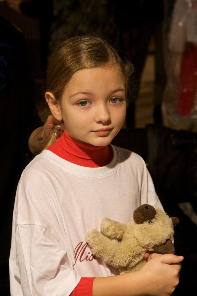 One first time model holding a favourite toy for comfort at Miss Blumarine backstage fall 2014