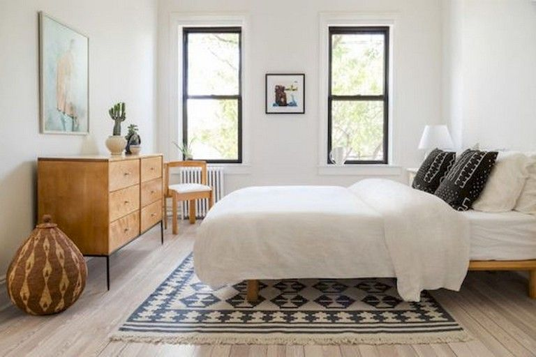 how to place a rug under a double bed