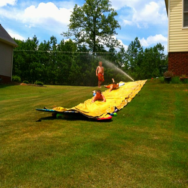 Tarp slip n' slide with baby oil and boggy boards. (put ...