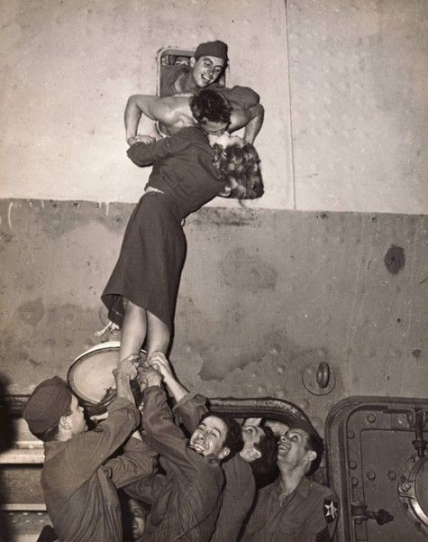 Marlene Dietrich passionately kissing a GI as he arrives home from World War II, New York, 1945 by Irving Haberman