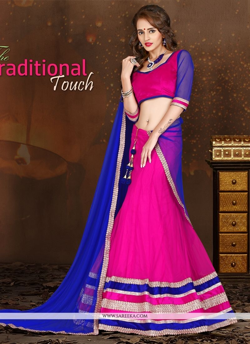 0c21765eed Appear ethnic with this affluent blue and hot pink net a line lehenga choli.