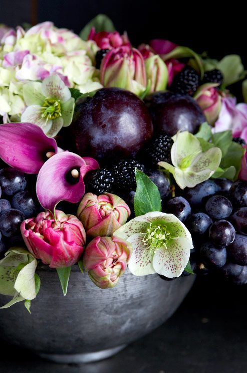 A beatiful arrangement of flowers, mixed with plums, grapes and blackberries♡