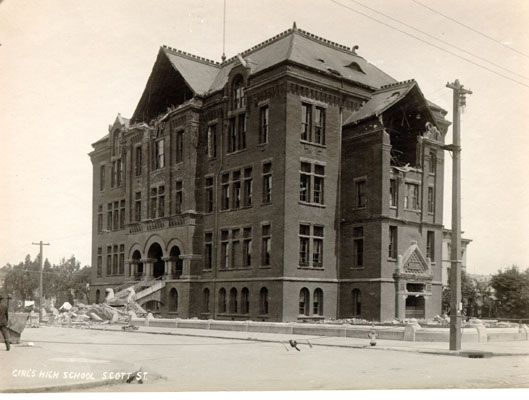 Girls' High School, located on Scott Street in San Francisco, damaged by the earthquake and fire of 1906 in a 1906 photo.  The Girls' High School was created in June 1864 when the city's first high school, San Francisco High, was split. A new four-story, red brick building was built on Geary, O'Farrell, and Scott. It later became Benjamin Franklin Middle School, and is now Gateway High School.
