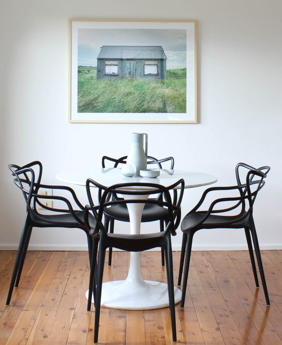 Home Staging Dining Room Table: Bold Artwork In This Small Space Dining Room. Marble Round