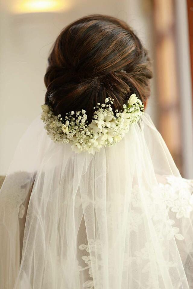 Love The Veil And Flower Placement Of This Updo Christian Bride Christian Wedding Dress Indian Bridal Hairstyles
