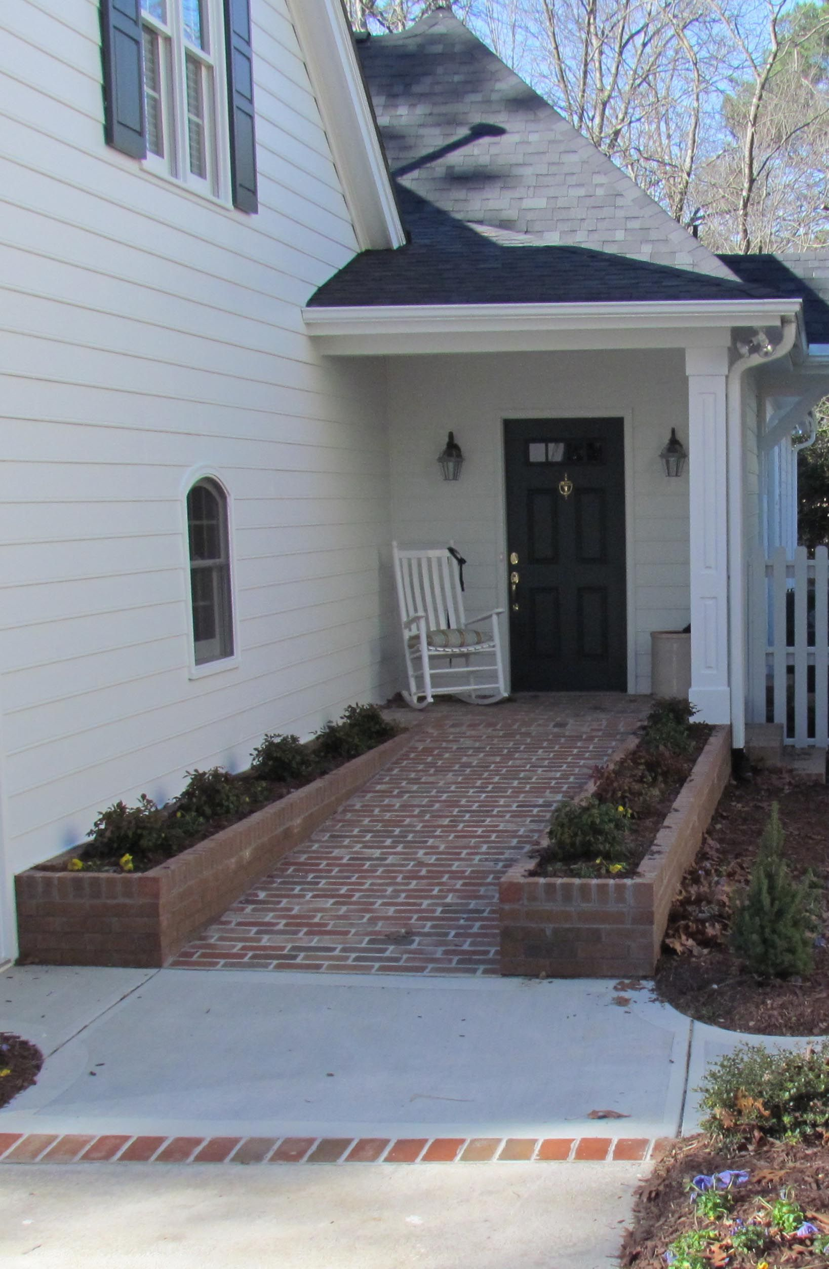ADA Accessible and still pretty  Vaughan Building   Remodeling created this  front entry with ramp using brick pavers that were recycled from the old  patio. Vaughan Building   Remodeling created this front entry with ramp
