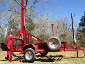 Man Drilling Water Well With A Deep Rock Drilling Rig Well Drilling Water Well Drilling Rigs Water Well Drilling