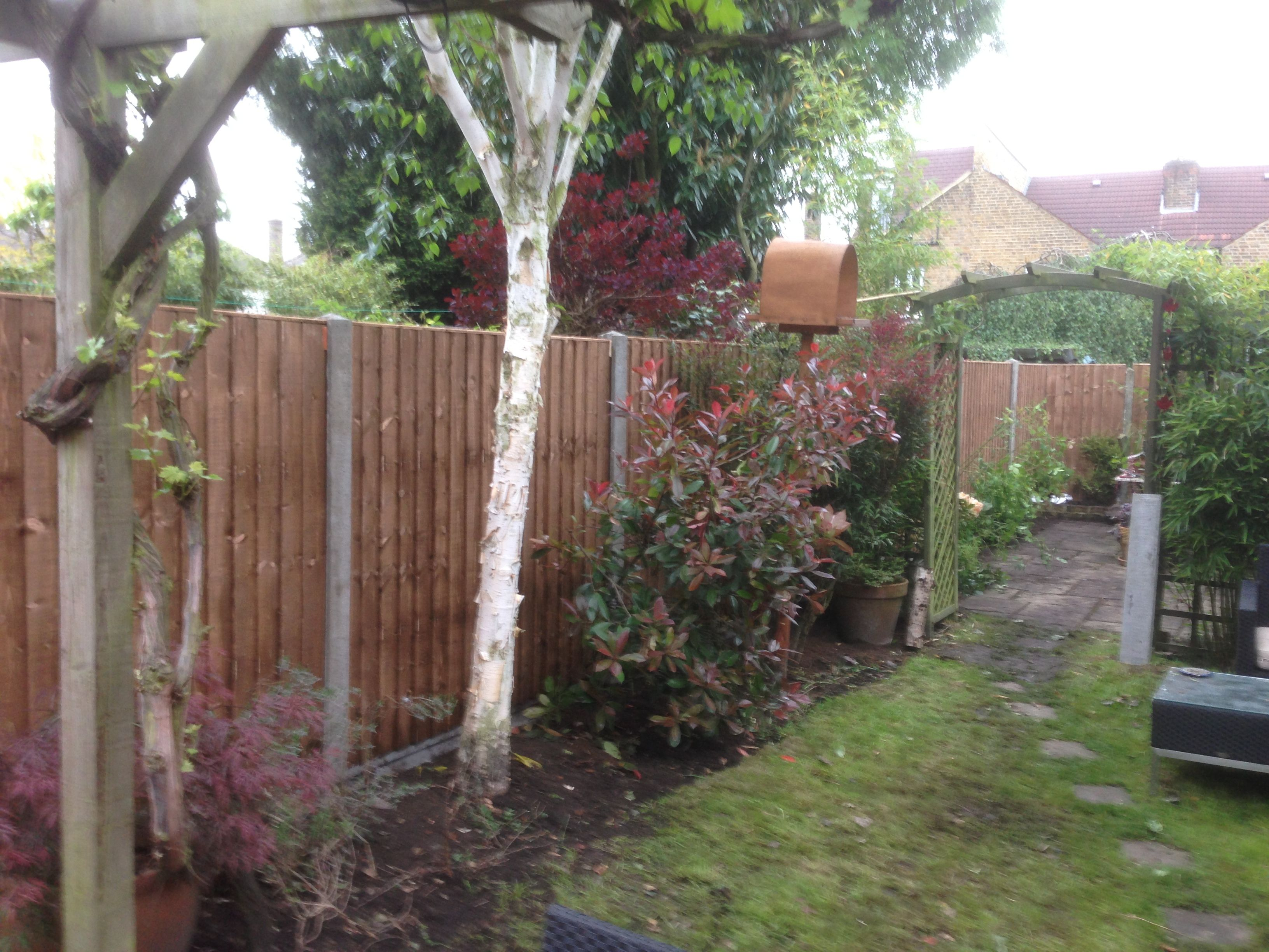 a new close board fence installation using concrete slotted post