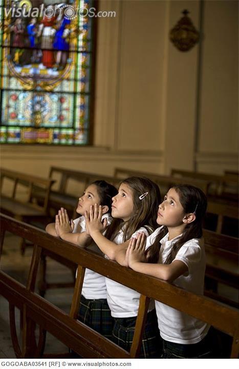 Praying in Church | Young students praying in church ...