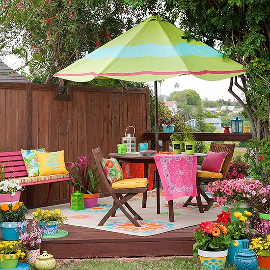 Color Your World in a shady yard by adding colorful pops of color with pillows, outdoor rug and umbrella.