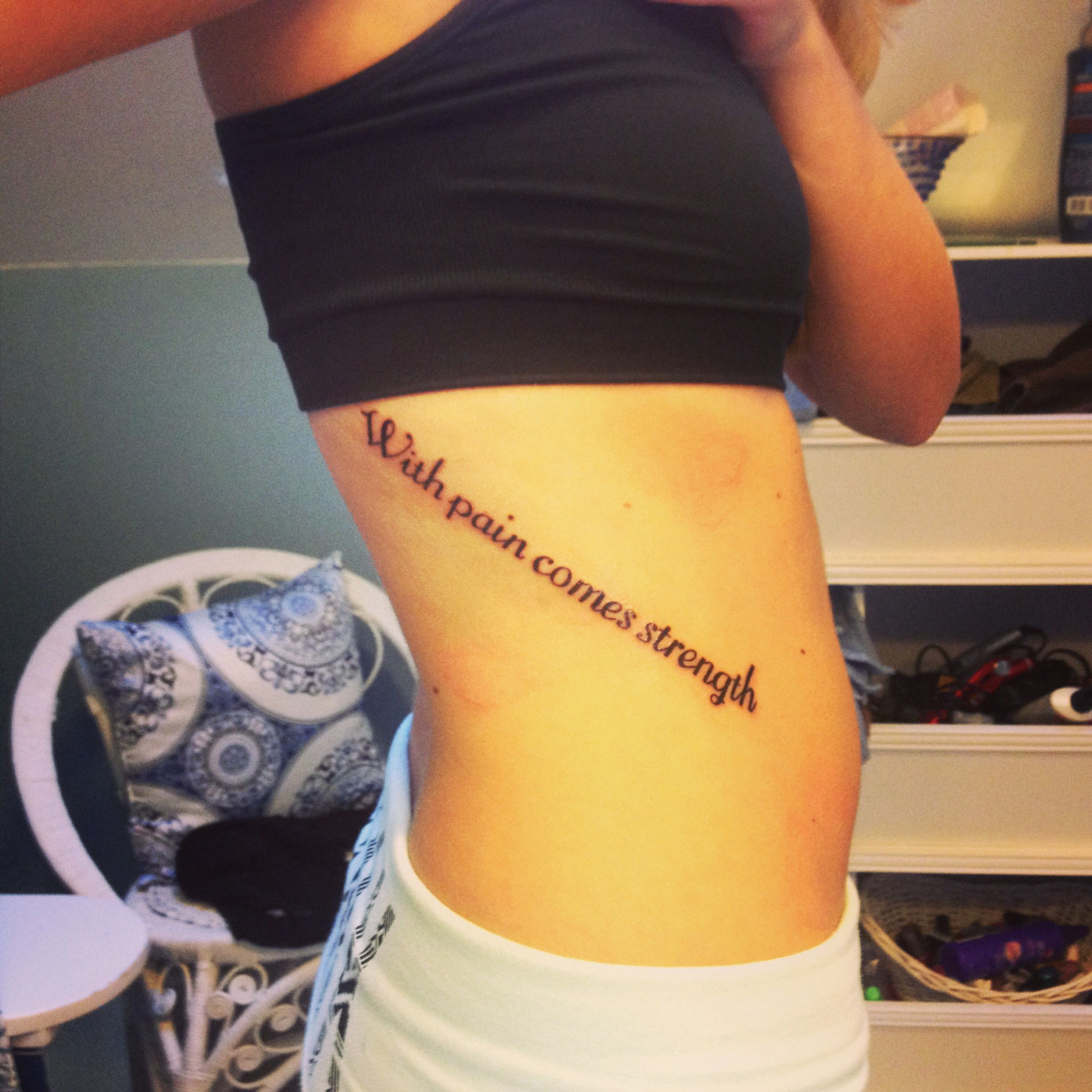 Tattoo Hurts Quotes: With Pain Comes Strength Rib Tattoo. Love The Placement
