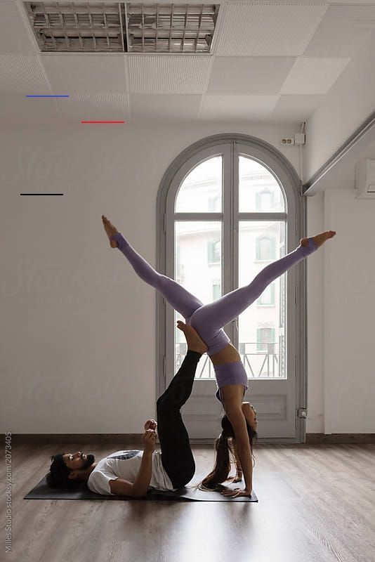 Couple showing beautiful yoga posture by Milles Studio for Stocksy United #acroyoga #partner #yoga #...
