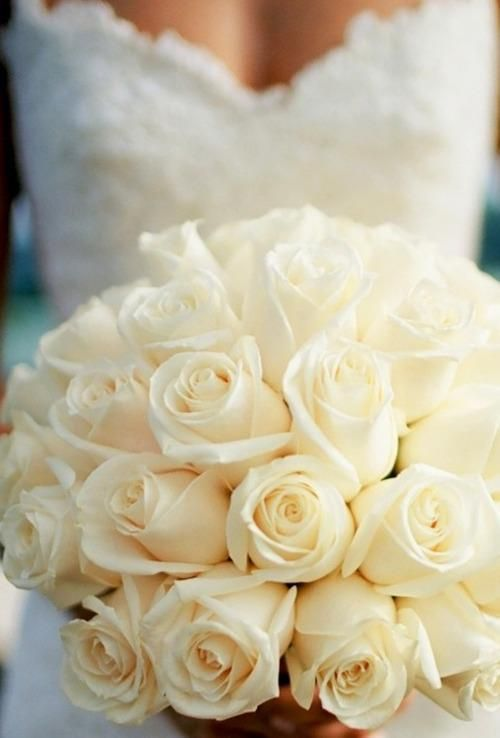 White Rose Wedding Bouquet. Sneak a few red roses in too