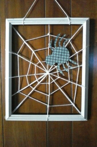 Old frame, paper spider and yarn. Spooky upcycle.
