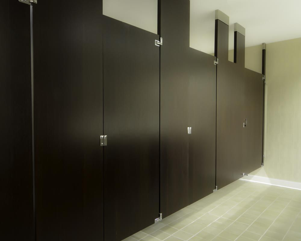 Ironwood Manufacturing wood veneer toilet partitions and bathroom doors. Beautiful, clean public bathroom stalls.