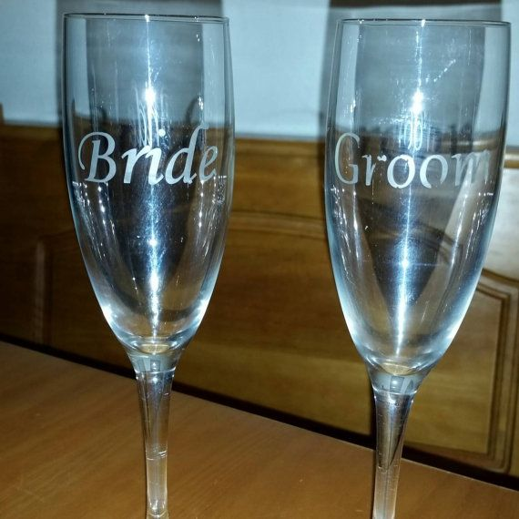 Check out this item in my Etsy shop https://www.etsy.com/listing/211332424/etched-champagne-flutes-bride-and-groom