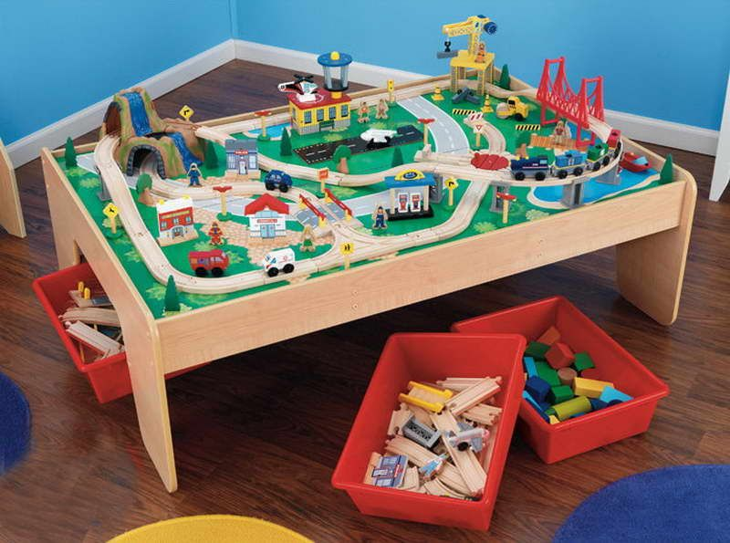 melissa and doug train table with a round rug