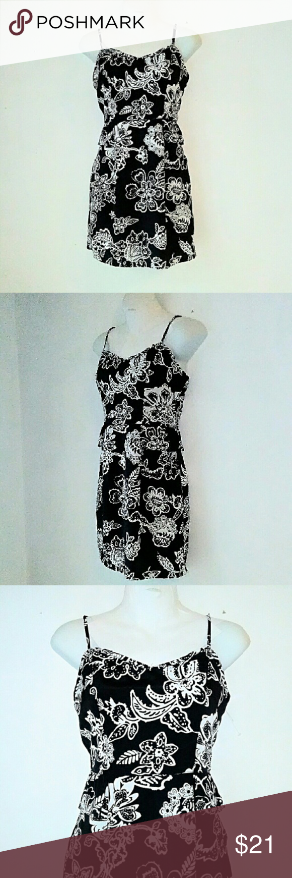 American Eagle Outfitters Floral Print Dress Black with white print dress. Features adjustable shoulder straps and a peplum ruffle at the waist line. Zipper on the back. And material is poly. Excellent like new condition American Eagle Outfitters Dresses Mini