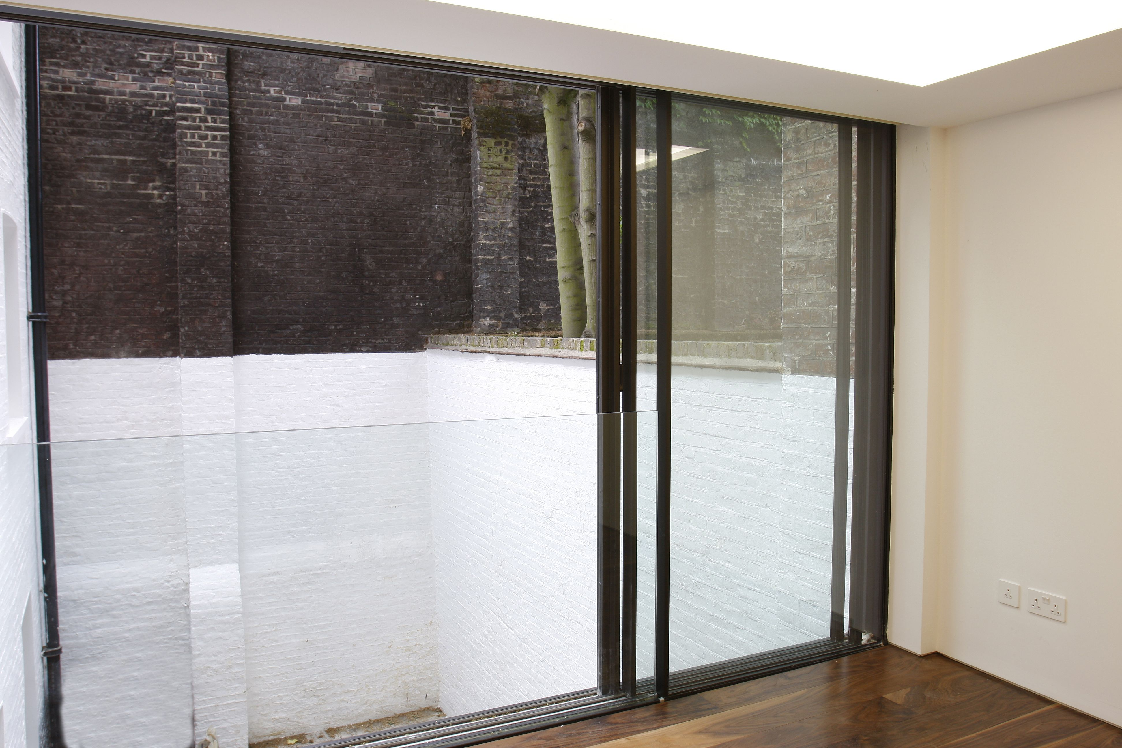 The Sliding Glass Panes Slide Behind The Fixed One With A