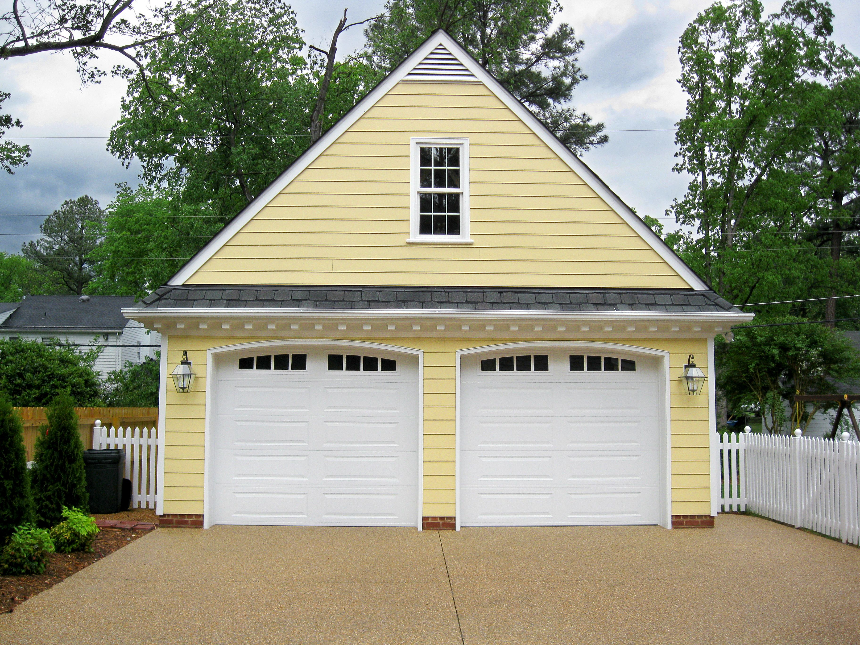 Custom Detached 2 Car Garage With Yellow Siding And White Trim By