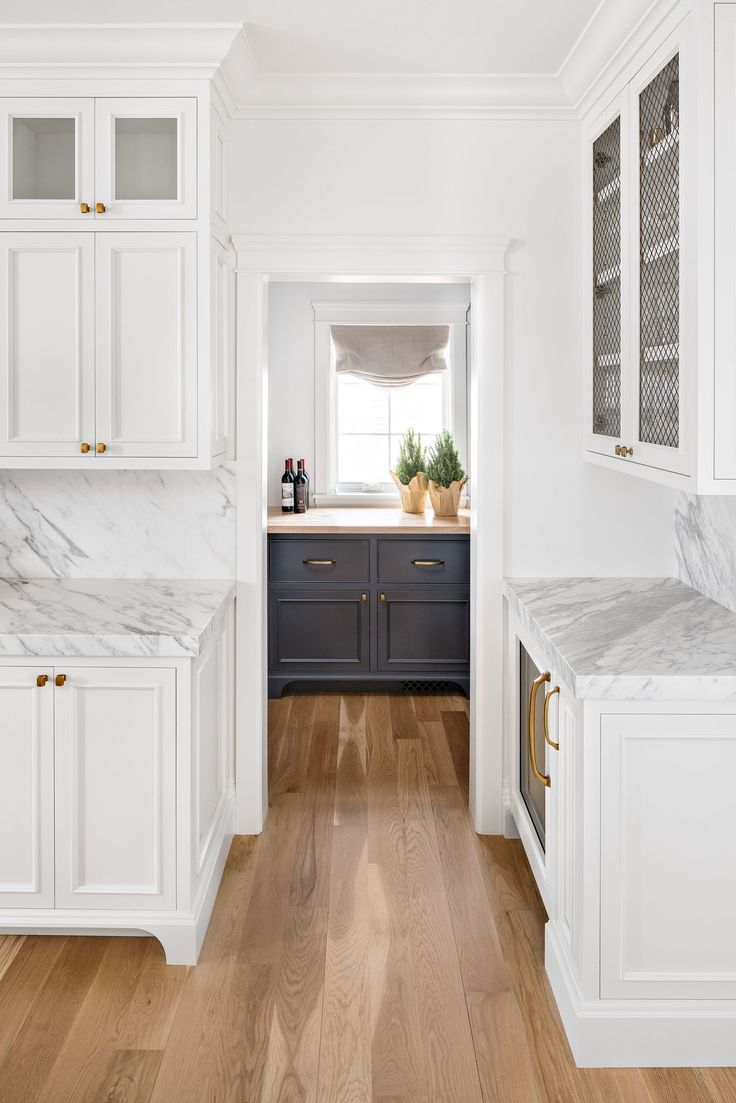 White Kitchen White Marble Countertop Matching Counter And Backsplash Black Cabinetry White Cabinetry