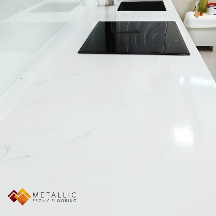 A Pure White Base With Faint Silver Veins Beautifying This Homeowner S Countertop Giving It A Epoxy Countertop White Quartz Countertop Diy Kitchen Countertops