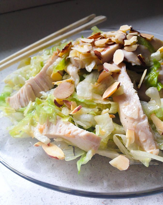 Asian salad with chicken, roasted almonds, and a homemade ginger dressing that will blow you away! SO GOOD.