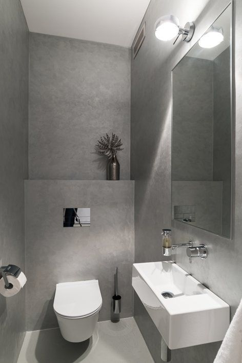 A Minimalist Guest Toilet Done With Concrete A Wall Mounted Sink A Lamp And A Large Mirror Small Toilet Room Gray Bathroom Decor Space Saving Toilet