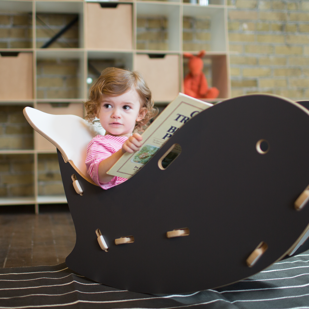 whale rocking chair  girl reading kids furniture and sprouts - click now for more super cute kids furniture adorable little girl readingin a grey
