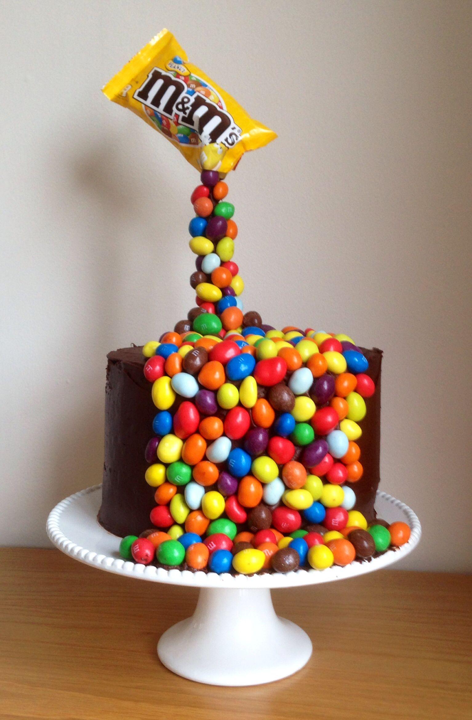 Giles birthday cake. M&M illusion gravity cake.