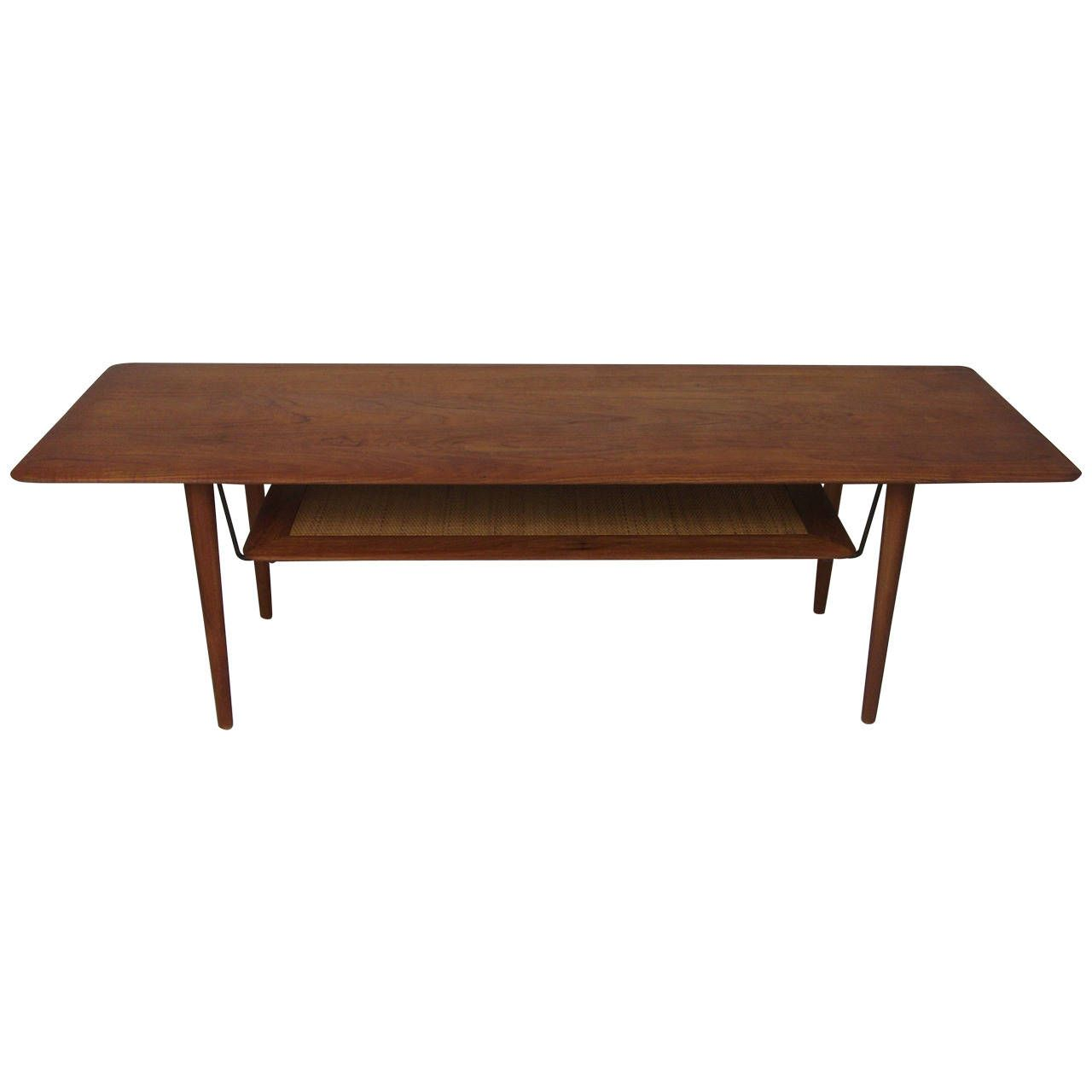 1950s Solid Teak Coffee Table Designed by Peter Hvidt & Orla Molgaard-Nielsen | From a unique collection of antique and modern coffee and cocktail tables at https://www.1stdibs.com/furniture/tables/coffee-tables-cocktail-tables/