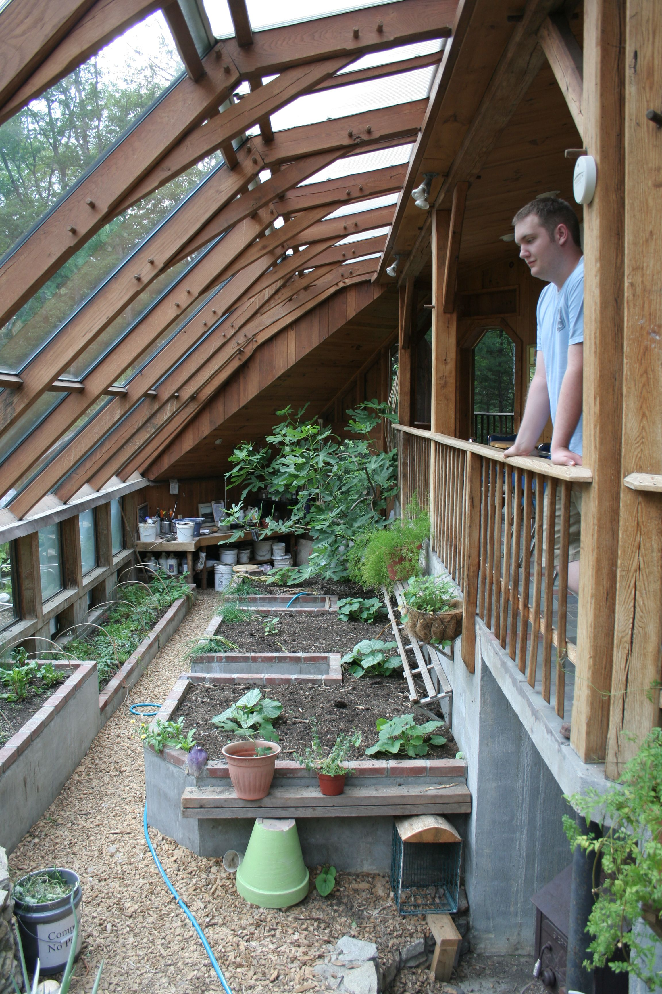 the greenhouse at sirius ecovillage uses solar exposure a shared wall with a hous. Black Bedroom Furniture Sets. Home Design Ideas