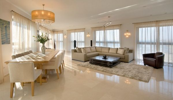 Living Room In Beige With A Clear Design And A Polished