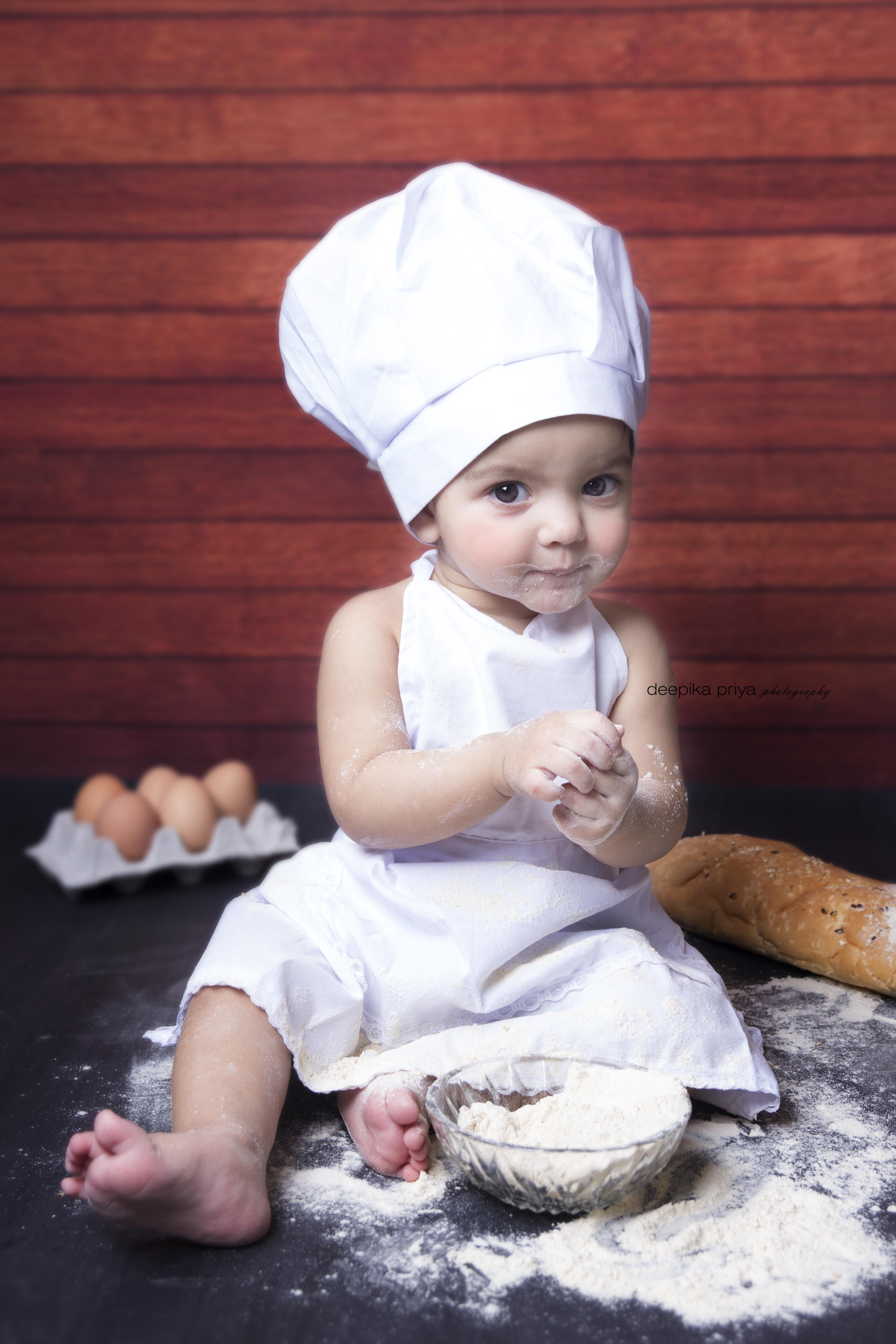 Master chef deepika priya photography deepika priya adorable kid infant photoshoot baby girl baker theme chef set lovely picture