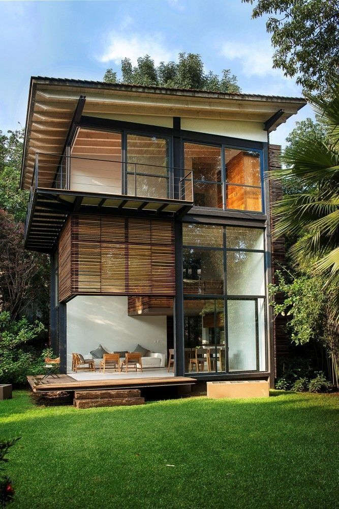 Modern Vertical Home With Small Living Dining And Garden Area