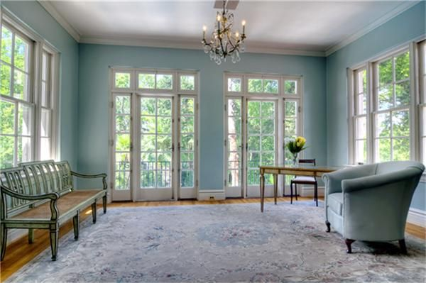 The morning room is filled with natural light from all the windows