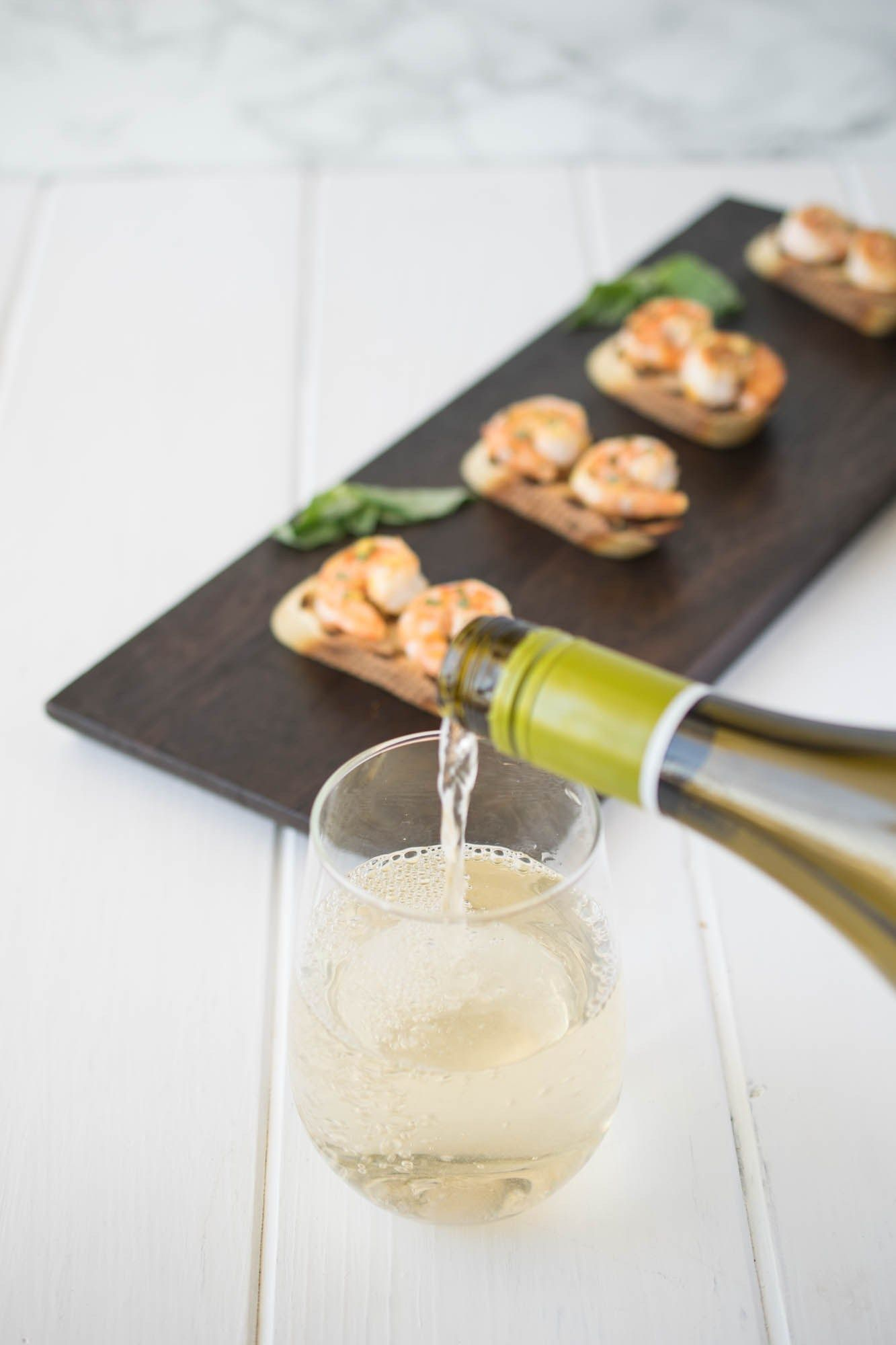 Shrimp bruschetta is the perfect summer-time appetizer. An easy, yet elegant dish that can be served while entertaining and pairs perfectly with a delicious fruity, crisp white wine.