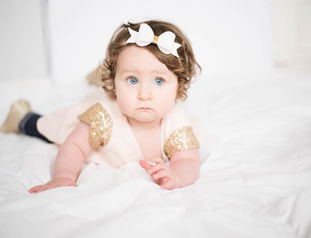 I can't handle those blue eyes! This little doll is just too gorgeous in our blush holiday blouse. @clarity_n_co has so many gorgeous bows to match too! Too much cuteness for one photo!