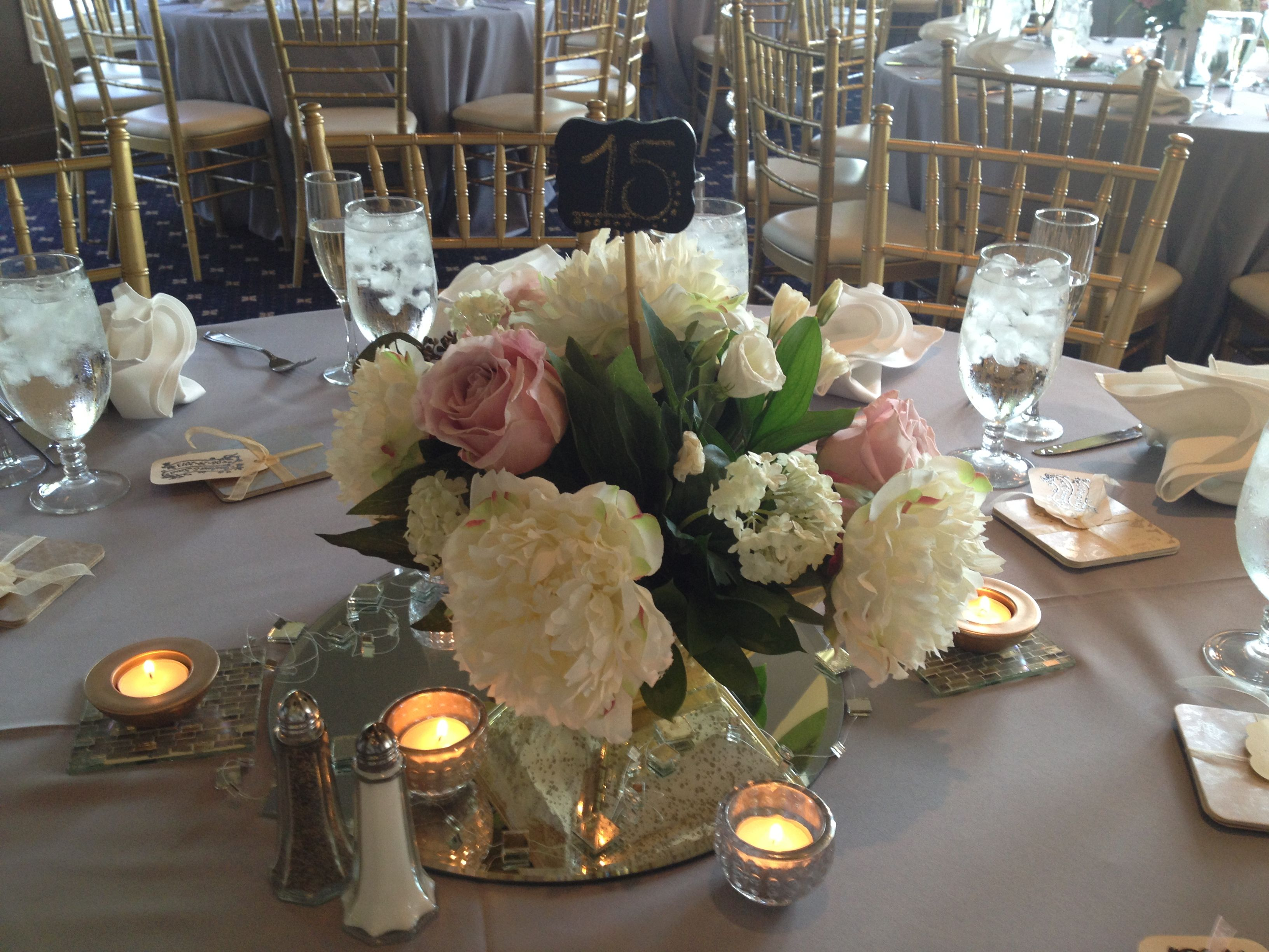 Reception centerpieces- Silk white peonies and viburnum and fresh roses picked in