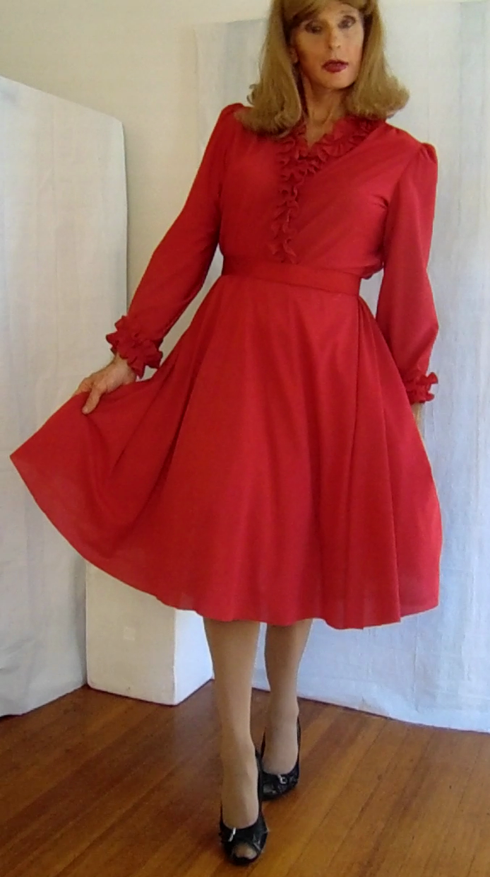 Tgirl wearing vintage red long sleeve dress maximum wow