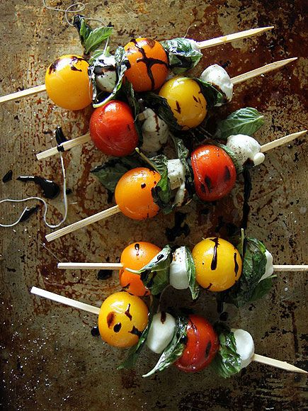 Put a Skewer In It! The Best Foods to Grill on a Stick   CAPRESE SALAD   All the flavors of the classic Italian salad, heated up on a smoky grill until the cheese is gooey and the tomatoes are charred and delicious.