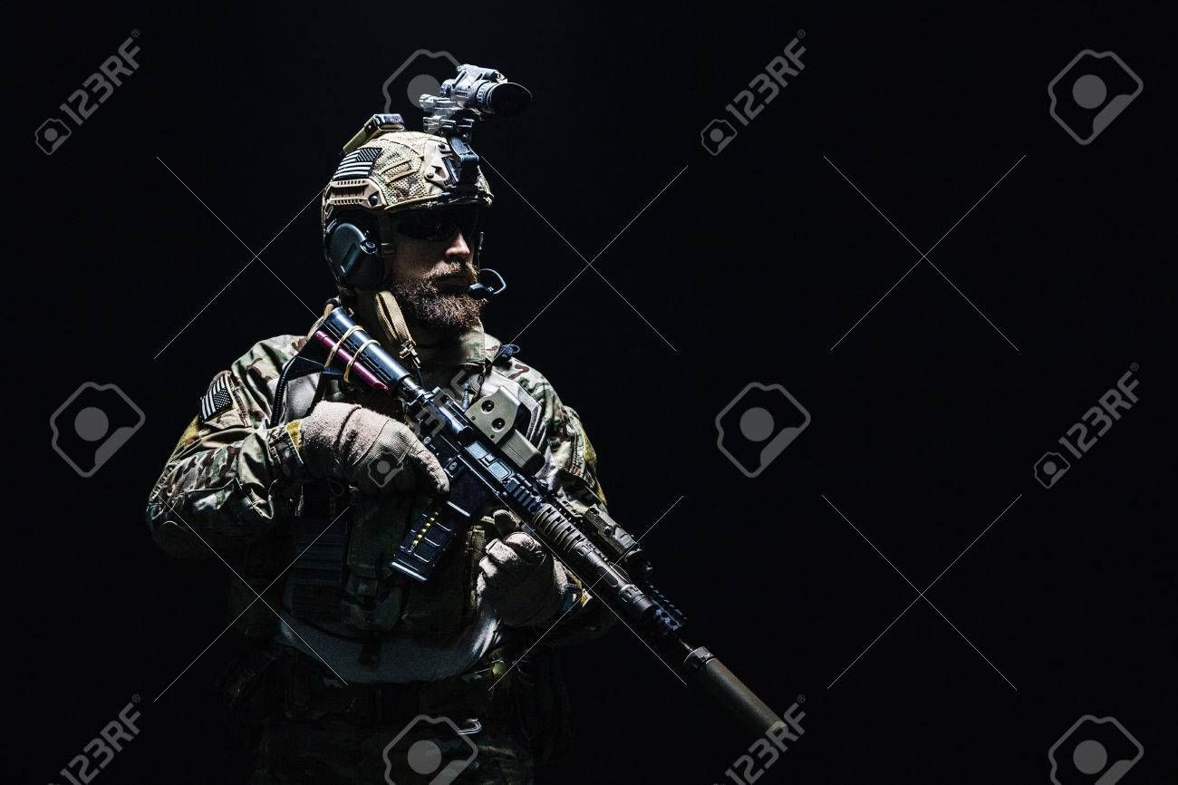 Bearded Soldier In Combat Uniforms With Weapon Plate Carrier And